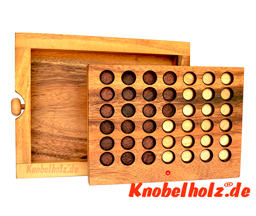 Strategy Game Connect Four as wooden game version with chips made of wood